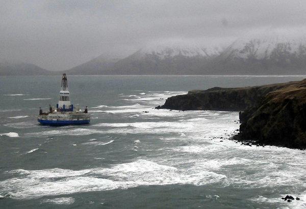 The Shell drilling rig Kulluk aground off a small island near Kodiak Island. Weather may affect retrieval efforts.