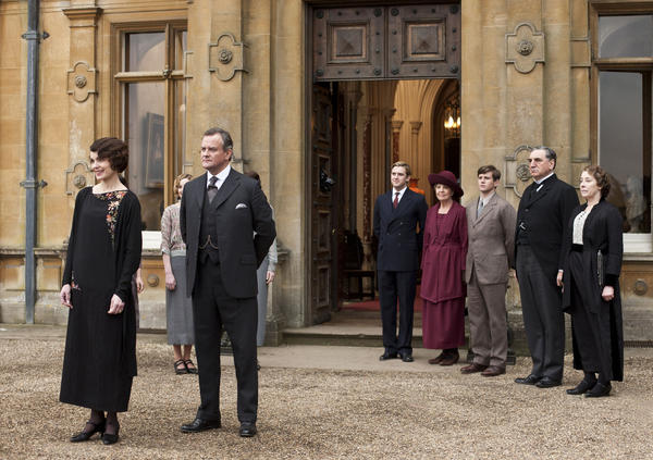 From left to right: Elizabeth McGovern as Lady Grantham, Hugh Bonneville as Lord Grantham, Dan Stevens as Matthew Crawley, Penelope Wilton as Isobel Crawley, Allen Leech as Tom Branson, Jim Carter as Mr. Carson, and Phyllis Logan as Mrs. Hughes.