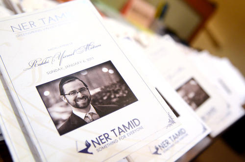 Programs featuring a picture of new rabbi Yisrael Motzen are on display at Ner Tamid Synagogue in Mount Washington. Motzen was installed Sunday, Jan 6, as the congregation's third rabbi in its history.