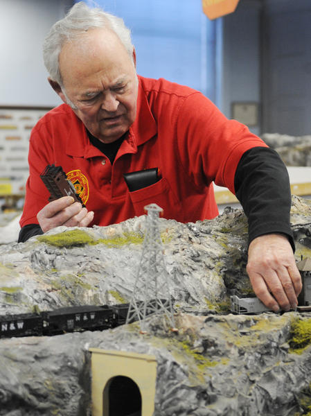 Bruce Kleppinger of East Allen Township fixes a coal train that derailed. The Black Diamond Society of Model Engineers held their 2013 Holiday Train Show Sunday afternoon showcasing their two floors of model train displays. The last chance to see the exhibit will be from 2-5 p.m. on January 12th and 13th. Admission is $4, children 12 and under are free. They are located at 900 East Macada Road in Bethlehem.
