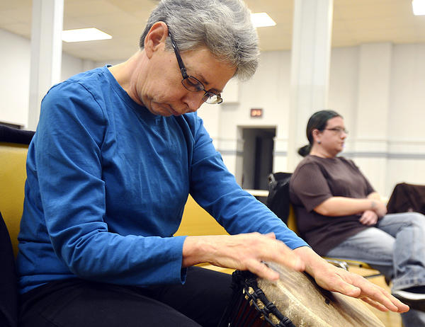 Harriett Diller of Chambersburg, Pa., plays a djembe drum Sunday with the Tri State Drum Circle at the Hagerstown Church of the Brethren.