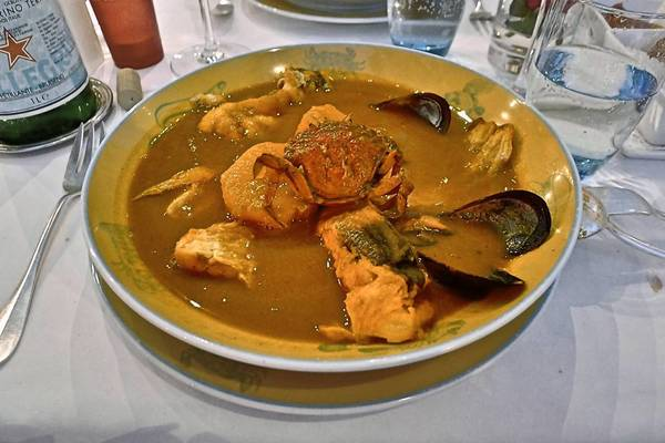 Bouillabaisse that includes small crabs and mussels