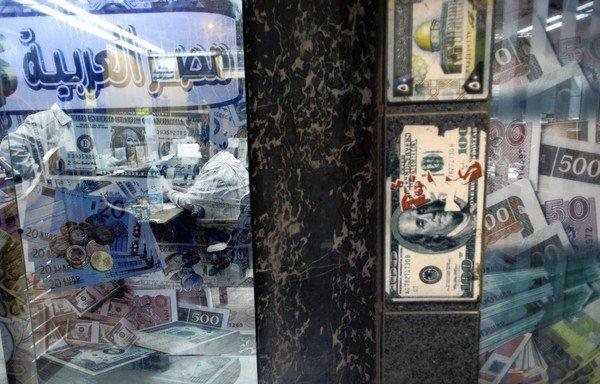 An Egyptian man exchanges foreign currency in Cairo. A Cabinet shake-up in Egypt sought to soothe concerns about President Mohamed Morsi's handling of the economy.