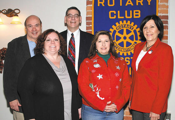 On Dec. 14, the Rotary Club of Hagerstown-Sunrise presented the proceeds from its 2012 Sun Rises Over Rotary Dinner and Auction to REACH Cold Weather Shelter; STAR Community; St. Ann Haiti Project; and its own Sunrise Rotary Foundation, which is maintained by the Community Foundation of Washington County. Front row, from left, Jodie Ostoich, REACH Cold Weather Shelter; Ginny Gaylor, STAR Community; and Agnes Supernavage, St. Ann Haiti Project. Back row, from left, Al Smith, Sunrise Rotary president; and Brad Sell, Community Foundation of Washington County executive director.