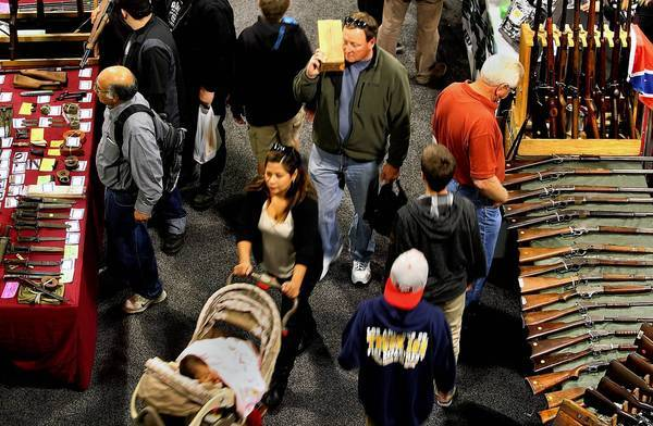 "People browse and buy at the Crossroads of the West gun show in Ontario. ""Obama is the No.1 gun salesman in the nation,"" one attendee said."