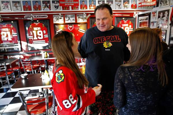 George Lemperis, owner of the Palace Grill, chats with Gina Boffa, left, and her sister Carla on Sunday after lunch at the restaurant on Madison Street. The Boffa family came to the Palace Grill to celebrate the end of the NHL lockout. The restaurant, which is east of the United Center, where the Blackhawks play, lost at least $75,000 in business over the last few months, Lemperis said.