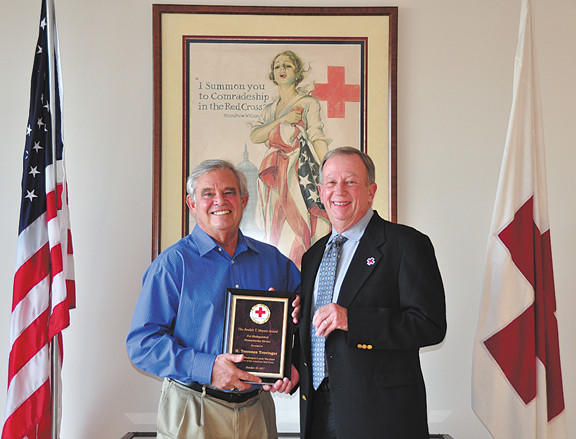 Terry Trovinger, left, winner of the chapter's highest award, the Beulah T. Meyers Award, is shown with Robert Carder, chairman of the board of directors for the Washington County Chapter of the American Red Cross.