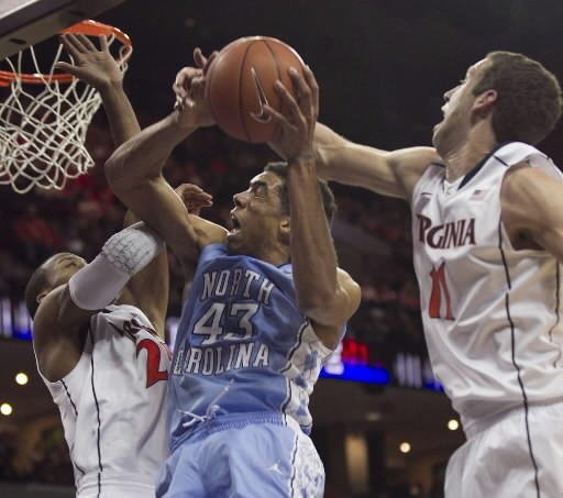 Akil Mitchell (left) and Evan Nolte defend James-Michael McAdoo