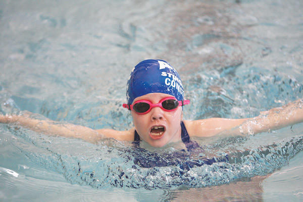 Carly Comstock of the Aberdeen Swim Club competes in the girls 8 and under 25-yard butterfly on Sunday at the Aberdeen Family YMCA. American News Photo by Ryan Deal