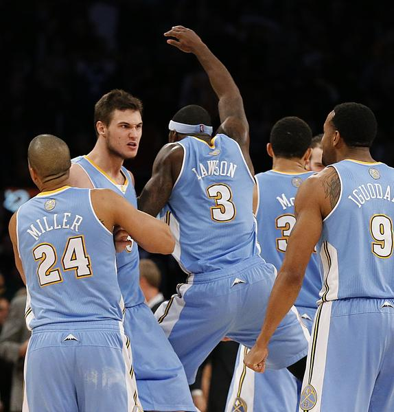 Nuggets forward Danilo Gallinari, second from left, celebrates with teammates after hitting a three-pointer to seal a win over the Lakers.