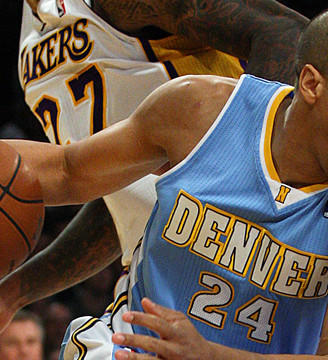 Nuggets guard Andre Miller drives past Lakers defender Jordan Hill.