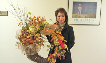 Erica Hunstad displays her holiday wreath from Kathleen's that she won during a raffle at the recent Aberdeen Public Schools Foundation Home for the Holidays Tour. The raffle item was sponsored by Delbert and Pam Dutenhoffer of Dutenhoffer Construction.