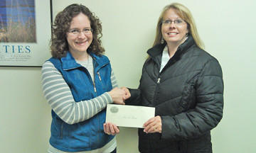 Gretchen Sharp, left, executive director of the Aberdeen Public Schools Foundation, shakes Angie Eisenbeisz's hand as she presents to her a $200 gift certificate to Lily's Floral and Gifts. Eisenbeisz won the gift certificate during a raffle at the recent Aberdeen Public Schools Foundation Home for the Holidays Tour. The raffle item was sponsored by Insurance Plus.