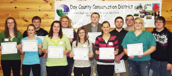 The Day County Conservation District awarded the Day County Conservation District Youth Scholarship on Dec. 3 at an appreciation banquet in Webster. Back row from left: Chelsea Ryan, Chad Sjurson, Shala Larson, Jacob Siglin, Joey Lesnar, Evan Johnson and Ryan Skadsen. Front row, from left: Jaime Sichmeller, Shannon Pappas, Bretni Sichmeller, Megan Nelson and Hayley Dunlavy. Each recipient received a $100 award for their involvement in conservation. The scholarships were presented by board members Mark Brandlee and Bonnie Headley.