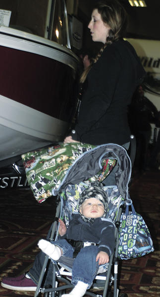 Kayla Schierholz of Redfield brought her 9-month-old son, Briar, to the Winter Big Boy Toy Show Sunday at the Ramkota Hotel.