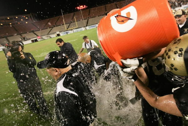 Tampa Plant coach Bob Weiner gets a celebratory shower after the Panthers won the Class 8A state title over Miramar in 2011.