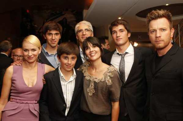 "Naomi Watts and Ewan McGregor flank the surviving family of the Indian Ocean tsunami, the Belon family, featured in the new movie ""The Impossible."" From left: Tomas, Simon, Enrique, Maria and Lucas Belon."