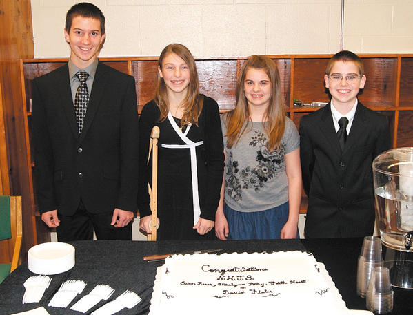 Freshman David Fisler, seventh-graders Maelynne Patey and Faith Horst, and eighth-grader Evan Reese were inducted into Heritage Academy's National Junior Honor Society on Dec. 13.