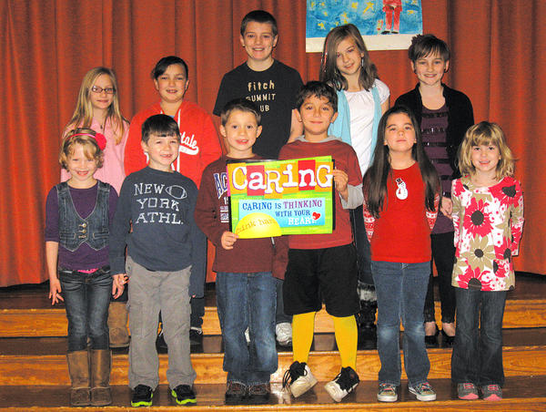 Potomac Heights Elementary School saluted 12 students in December for exemplifying the character traits of caring students. Front row, from left, Chloe McArthur, Owen McChesney, Thomas Hudak, Hayden Winnings-Hall, Ava Hainline and Anna Boyer. Back row, Brooke Keller, Katie Getz, Hunter Keller, Lexi Cabrera and Annie Goble. Not pictured: Alyssa Hines.