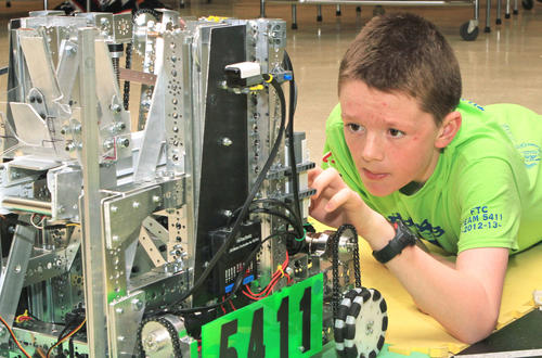 Noah Bailey, 13, of the Petoskey Middle School robotics team, Geeks, Gears and Gadgets, makes a few adjustments to the robot before the demonstration at Petoskey High School. The 20 member middle school team won the highest honor, the Inspire Award, at the First Tech Challenge competition in Grand Rapids this year.