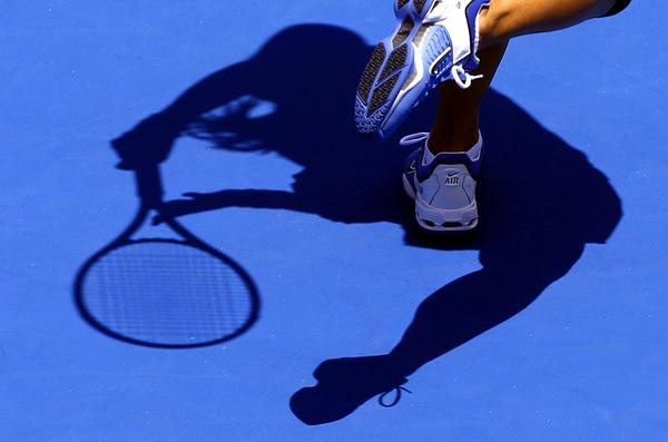 China's Li Na casts a shadow as she hits a shot during her first round match against Christina McHale of the U.S. at the Sydney International tennis tournament January 7, 2013.
