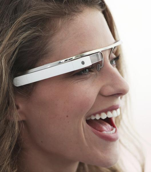 "Similar to the Google Glasses, Vuzix is expected to release the Vuzix Smart Glasses. The M100 Smart Glasses offer a hands free display and hook over ear like a Bluetooth. With its virtual display and Android operating system, the Vuzix smart glasses is expected to be a big hit at the 2013 CES. (Google Glasses shown in picture.) Information gathered from <a href=""http://www.engadget.com./2013/01/06/vuzix-smart-glasses-m100-hands-on/"">Engadget.com</a>"