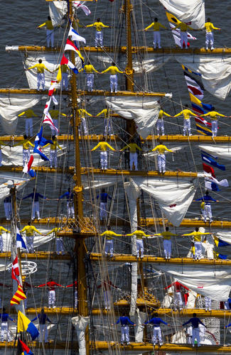 Gloria sailors top out their ship with vivid color as the ship transits the Elizabeth River to downtown Norfolk for OpSail Virginia 2012.