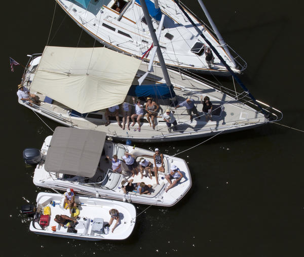 Boaters tie their crafts together to watch the OpSail 2012 Virginia parade of sail pass on the Elizabeth River on Friday. Thousands gathered on the water and on shore to watch the event to commemorate the War of 1812.