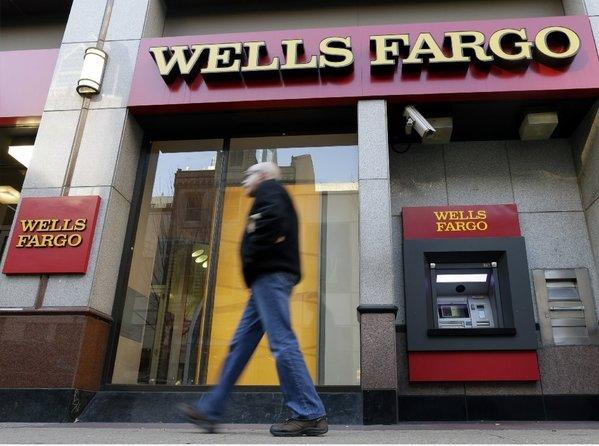 A man walks past a Wells Fargo location in Philadelphia.
