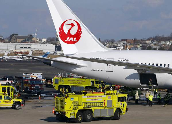 Fire trucks surround a Japan Airlines Boeing 787 Dreamliner that caught fire at Logan International Airport in Boston, Massachusetts today. The parked Boeing Co 787 Dreamliner aircraft with no passengers on board caught fire at Boston's Logan International Airport while parked at a gate on Monday morning, an airport spokesman said.