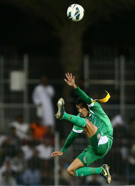 Younus Mahmood of Iraq jumps for the ball during his team's match against Saudi Arabia in the 21st Gulf Cup in the Bahraini capital Manama, on January 6, 2013.