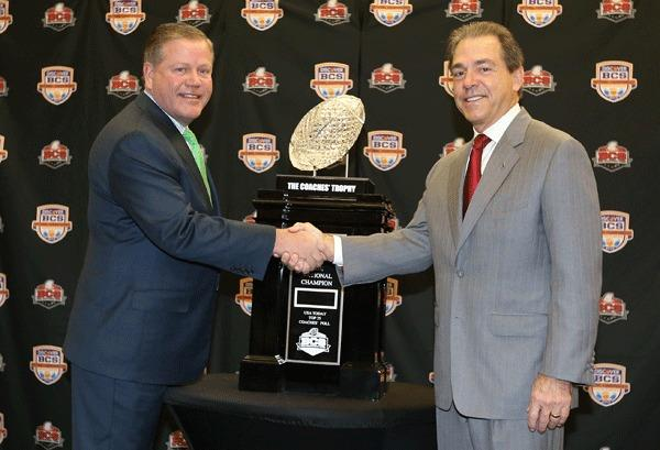 Notre Dame head coach Brian Kelly (left) shakes hands with Alabama Crimson Tide head coach Nick Saban during a press conference for the 2013 BCS National Championship game at Harbor Beach Marriott Resort & Spa.
