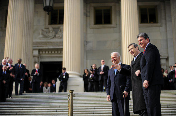 Sen. Mark Kirk (R-Ill.), center, Vice President Joe Biden, left, and Sen. Joe Manchin (D-W.Va.), right, were seen on the steps of the U.S. Capitol in Washington, D.C., before the 113th Congress convened Thursday.