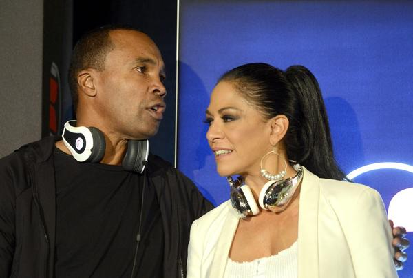 Retired boxer Sugar Ray Leonard and musician Sheila E wear Monster headphones during a news conference.