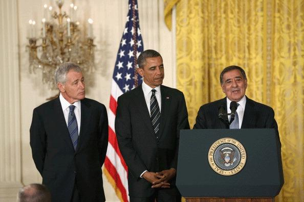 U.S. President Barack Obama (C) and former U.S. Sen. Chuck Hagel (R-NB) (L) listen as Secretary of Defense Leon Panetta speaks during a news conference in the East Room at the White House on January 7, 2013 in Washington, DC. (Photo by )