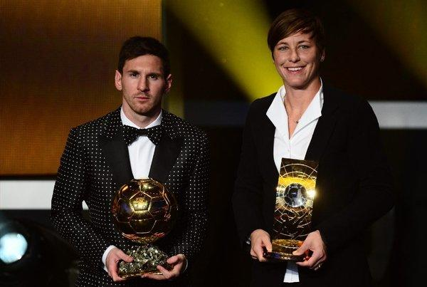 Lionel Messi and Abby Wambach accept their awards.