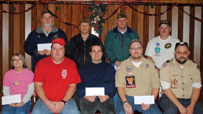 Confluence Veterans of Foreign Wars Post 7250 presented checks to various organizations. From left, front row are: Janice Brown Fike, representing The Confluence Lending Library; Scott Holliday, representing Confluence Volunteer Fire Department; Kurt Miller, representing Turkeyfoot Valley Historical Society; Tom Holliday and Bill Conn, representing Confluence Boy Scout Troop 150. Back row: Ron Hostetler, also representing Confluence Fire Department; Confluence VFW Post 7250 Past District Commander, Harry Hinzy Sr.; Commander John Peck and Past Post Commander, Ron Tressler.