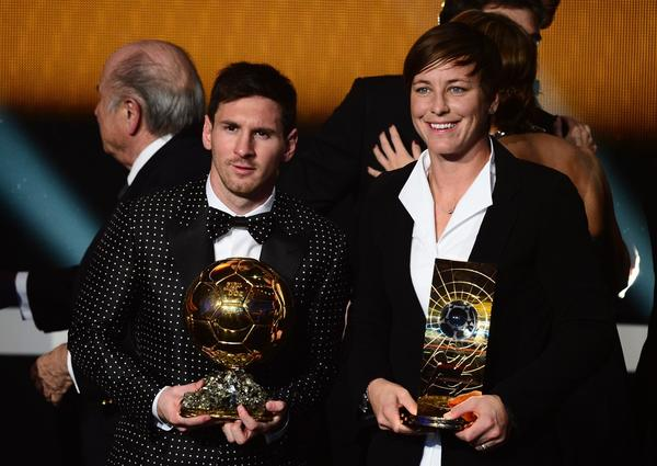 FIFA Ballon d'Or award winner Barcelona's Argentinian forward Lionel Messi (L) poses with FIFA Women's footballer of the year US forward Abby Wambach after the FIFA Ballon d'Or awards ceremony at the Kongresshaus in Zurich on January 7, 2013.