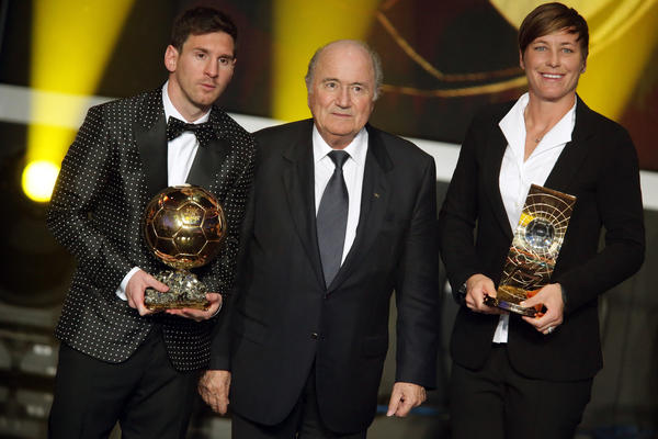 Lionel Messi of Argentina receives the FIFA Ballon d'Or 2012 trophy and Abby Wambach of United States receives her FIFA womens player of the year trophy by Joseph Blatter, FIFA president (C) during the FIFA Ballon d'Or Gala 2013 at Congress House on January 07, 2013 in Zurich, Switzerland.