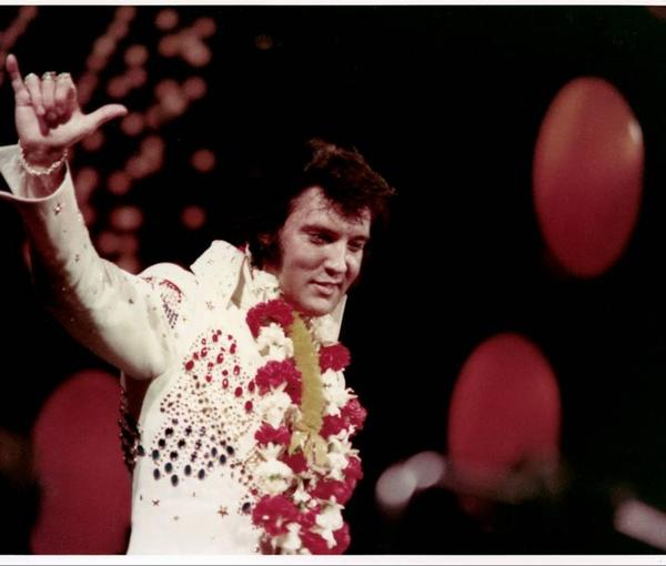 "Elvis Presley during his 1973 concert telecast around the world, ""Aloha From Hawaii Via Satellite."""