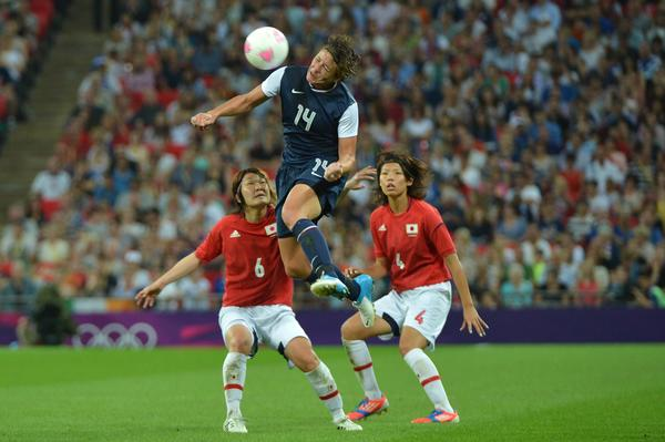 United States's forward Abby Wambach fights for the ball with midfielder Mizuho Sakaguchi and defender Saki Kumagai during the final of the women's football competition of the London 2012 Olympic Games USA vs Japan on August 9, 2012 at Wembley stadium in London. The US team defeatd Japan 2-1 to win the gold medal.