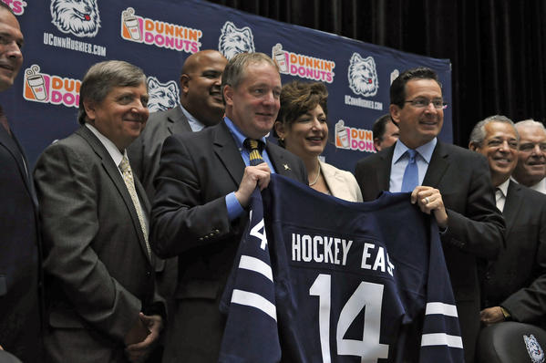 UConn hockey coach Bruce Marshall with school president Susan Herbst and Gov. Dannel Malloy in June when it was announced the school was joining Hockey East. (JOHN WOIKE)