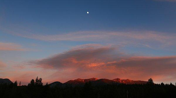 The moon rises above Sierra Nevada peaks near South Lake Tahoe.