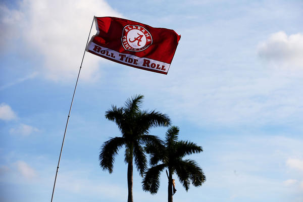An Alabama flag waves before the 2013 Discover BCS National Championship game between the Alabama Crimson Tide and the Notre Dame Fighting Irish at Sun Life Stadium on January 7, 2013 in Miami Gardens, Florida.