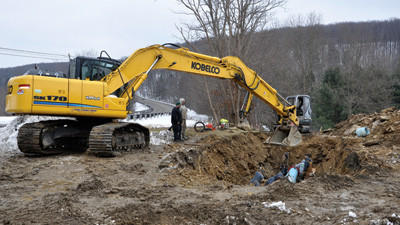 A Berkey Excavating crew works on a break in the Quemahoning pipeline off Route 985 near Sipesville Monday.