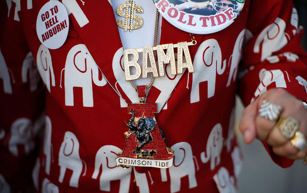 An Alabama Crimson Tide fan shows his outfit outside Sun Life stadium before the BCS National Championship college football game between Alabama and the Notre Dame Fighting Irish in Miami, Florida January 7, 2013.