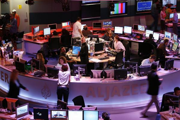Al Jazeera's Qatar-based newsroom is seen in 2006. If Al Jazeera's stepped up presence in the United States can help huamanize the Arab and Islamic world, it can provide a badly needed bridge for peace and understanding.