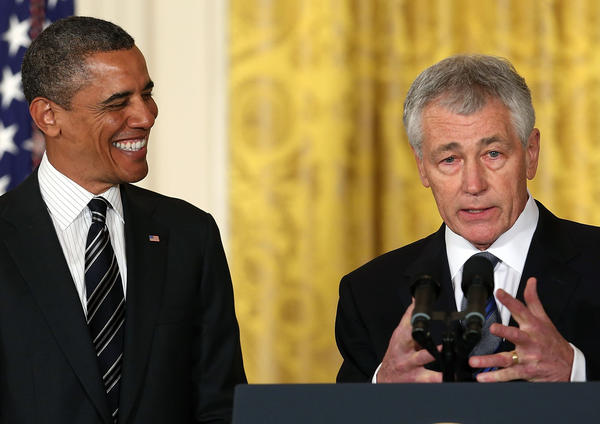 Former Sen. Chuck Hagel (R-Neb) speaks after President Obama, left, nominated him to replace Secretary of Defense Leon Panetta during an event in the East Room at the White House in Washington, D.C.
