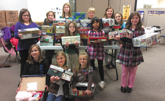 Girl Scouts from Troops 40169 and 40708 helped volunteers fill more than 200 shoe boxes for Operation Christmas Child.
