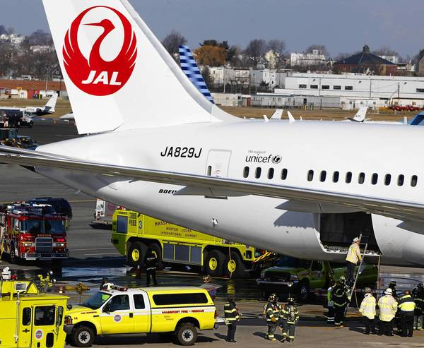 A Japan Airlines Boeing 787 Dreamliner jet is surrounded by emergency vehicles while parked at a terminal at Logan International Airport in Boston. The Dreamliner has had numerous problems over the years.